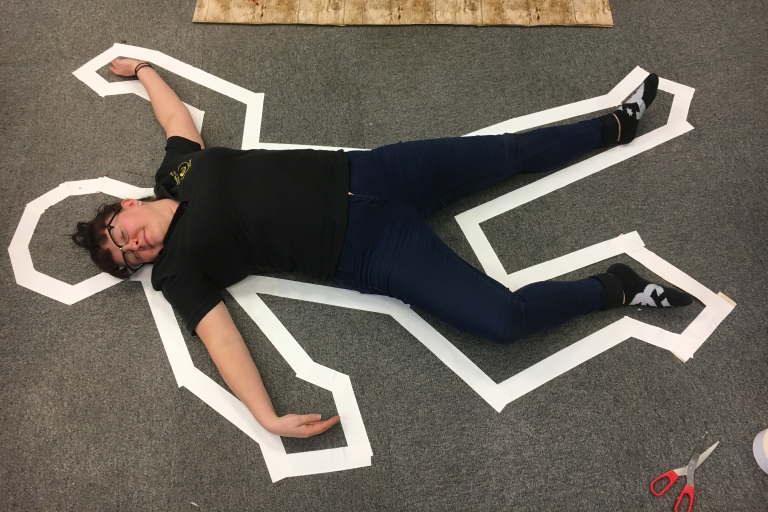 CSI Training and Events - Director Dionne lying in a body outline