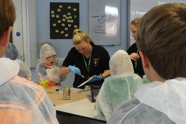 CSI Training and Events - CSI Educational Workshops - Angela and Dionne demonstrating fingerprints at a School Event