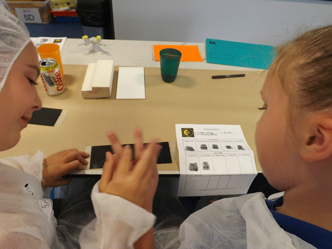 CSI Training and Events - CSI Educational Workshops - Children taking eachothers inked fingerprints at a school event
