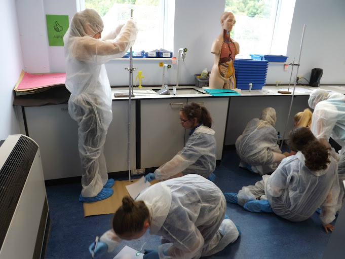 CSI Training and Events - CSI Educational Workshops - Pupils creating blood patterns at a school event
