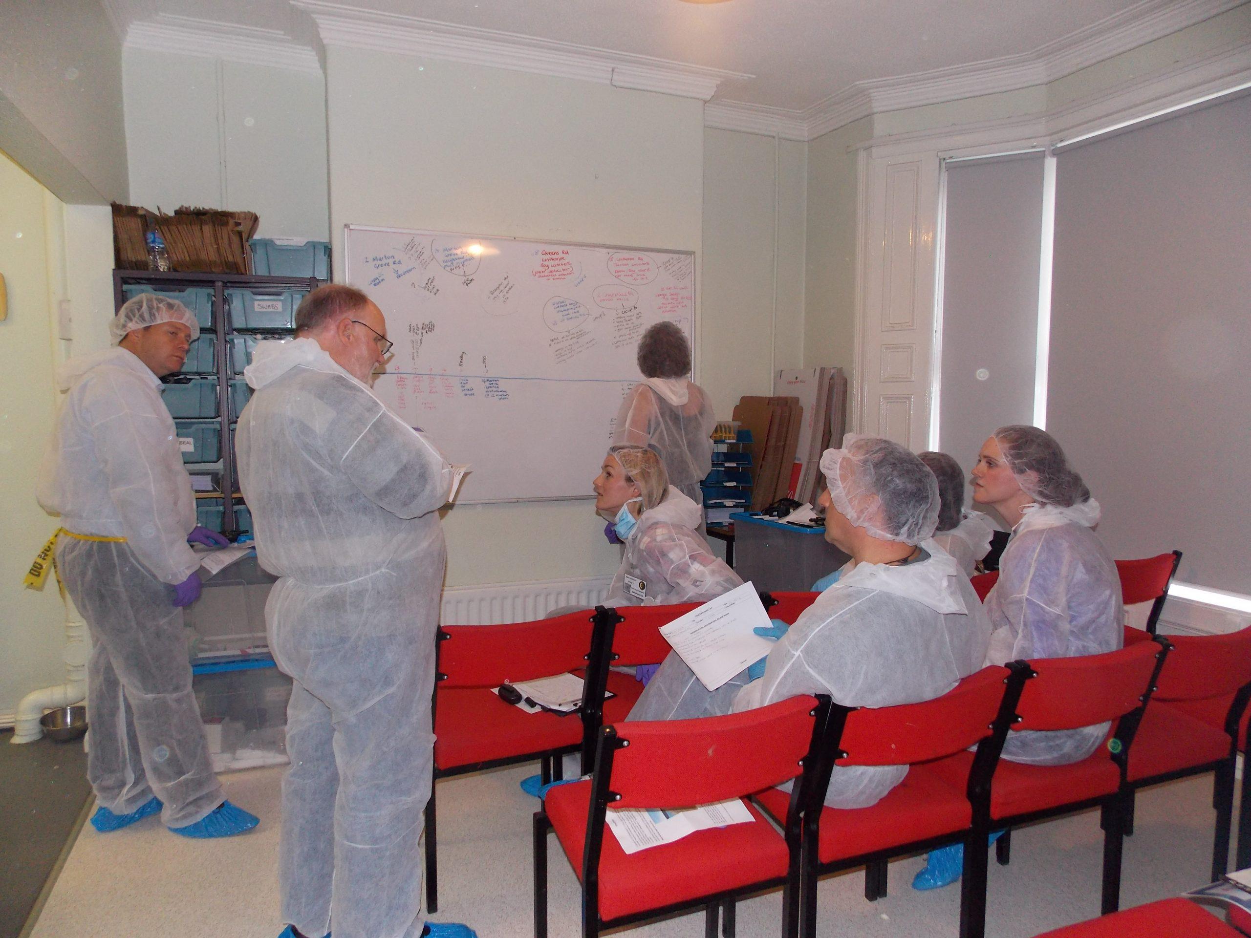 CSI Training and Events - Delegates building a timeline a CSI team building event