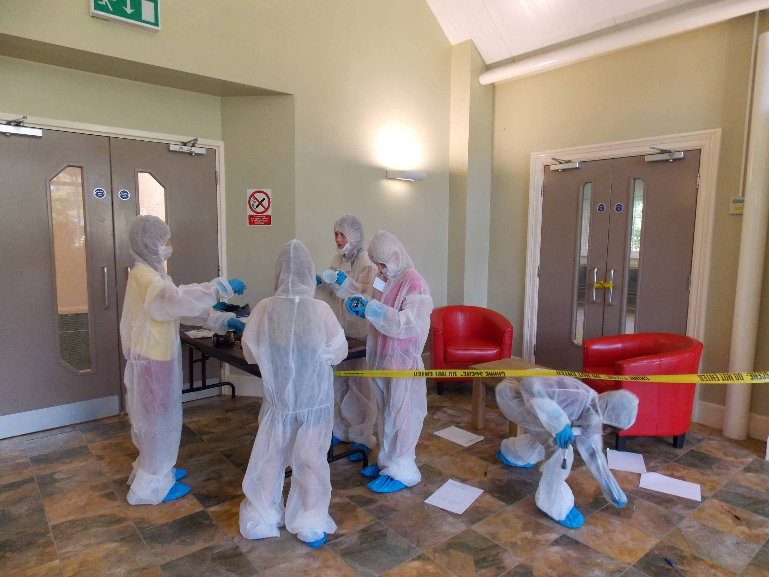CSI Training and Events - CSI Educational Workshops - Children examining a staged crime scene
