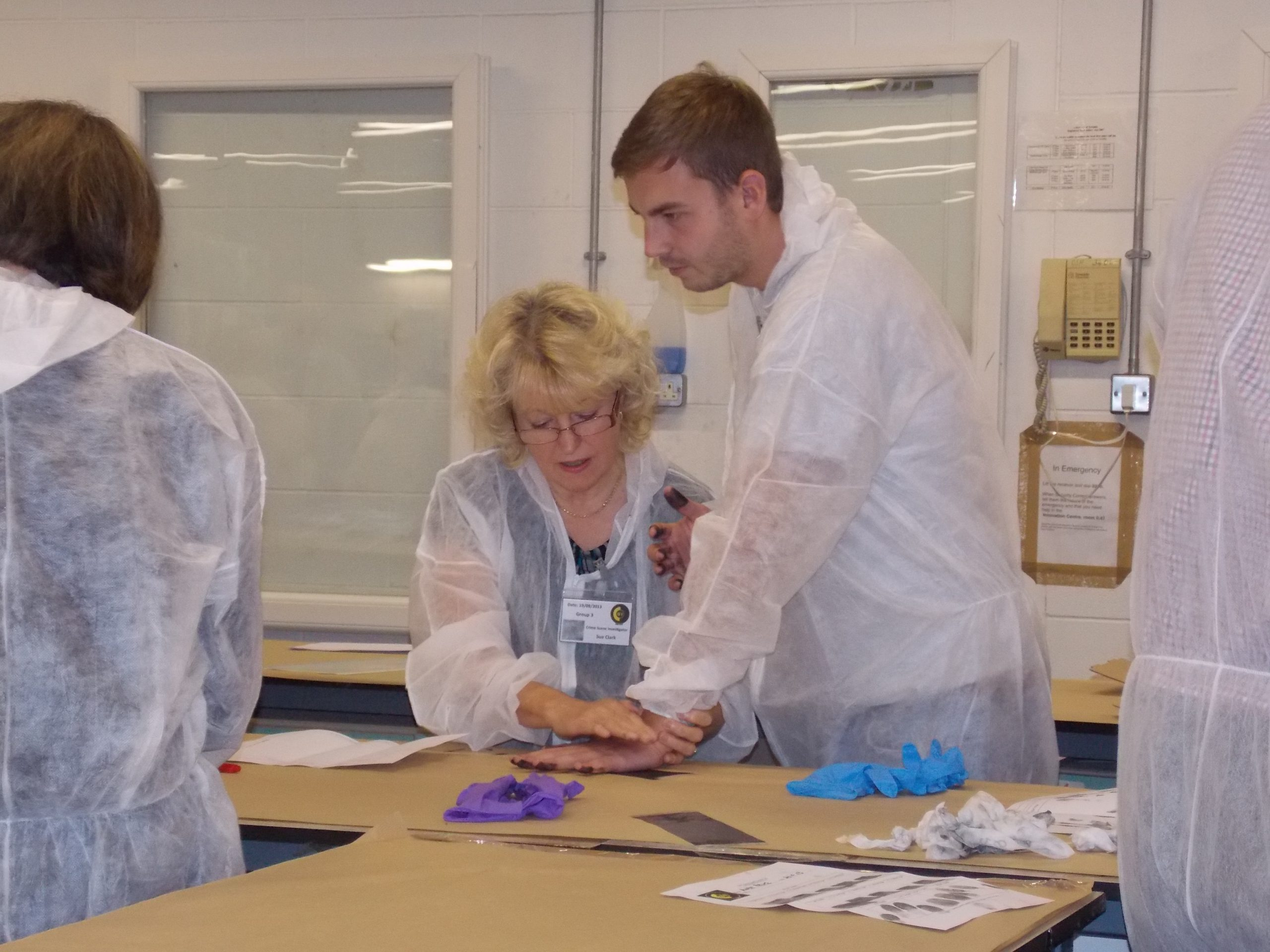CSI Training and Events - Delegates taking inked fingerprints at a CSI team building event