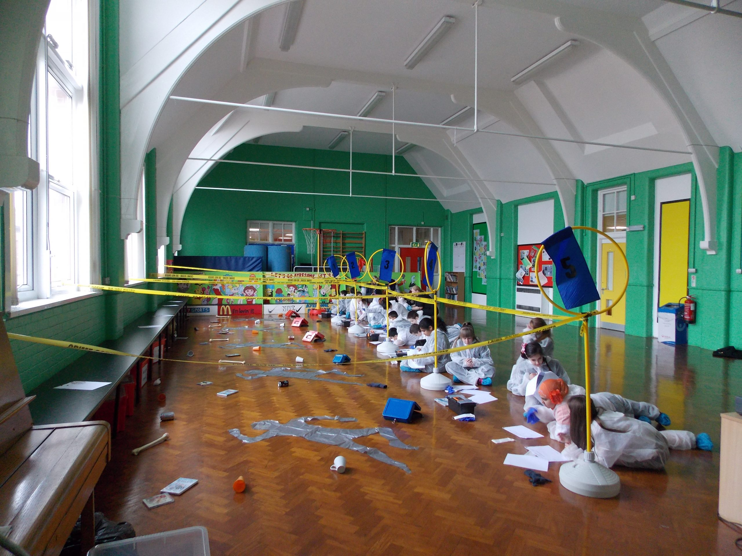 CSI Training and Events - CSI Educational Workshops - Children drawing a staged crime scene at a school event