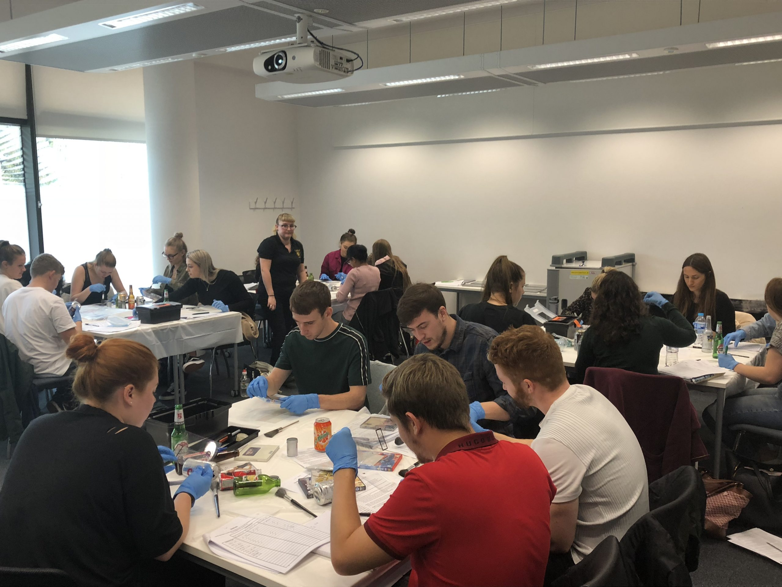 CSI Training and Events - CSI Educational Workshops - University Students examining items for fingerprints