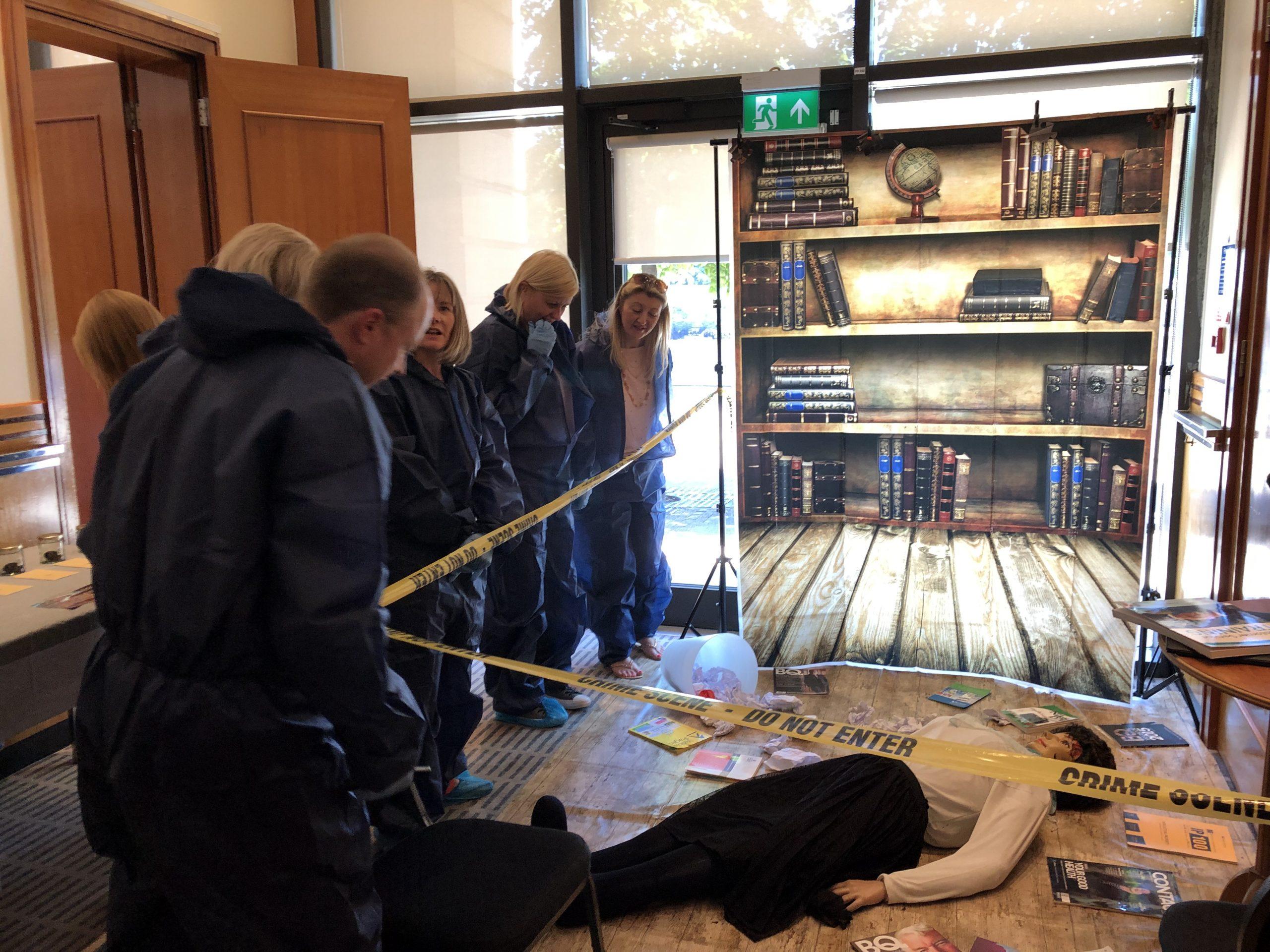 CSI Training and Events - Delegates examining a crime scene at a CSI team building event