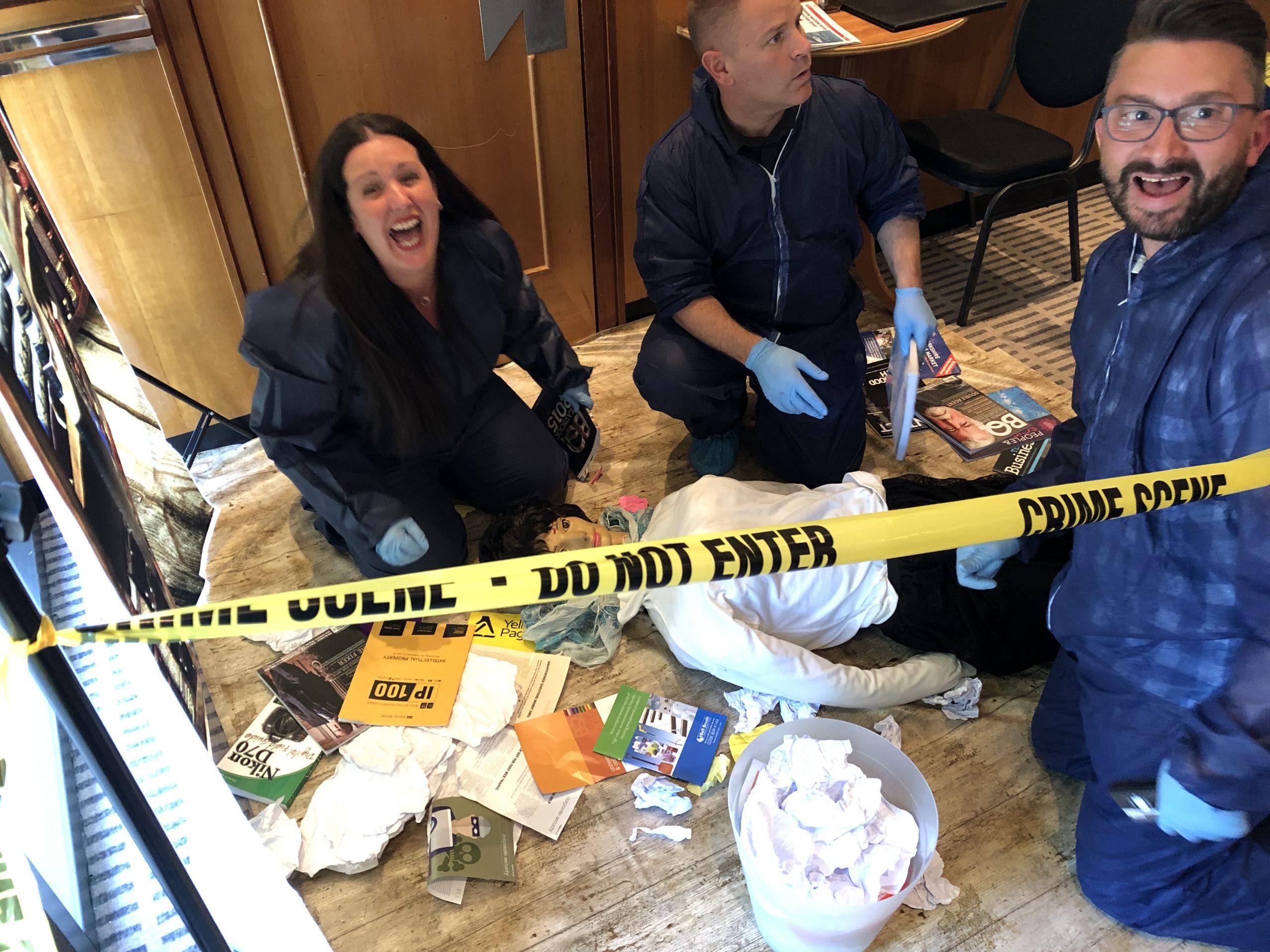 CSI Training and Events - ITV signpost Delegates examining a crime scene at a CSI team building event