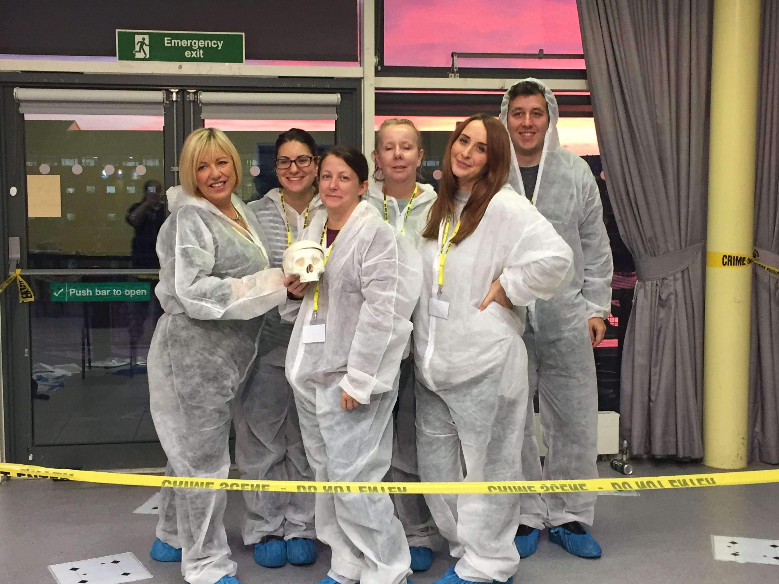CSI Training and Events - team photo, whilst holding a skull at a CSI Team building event