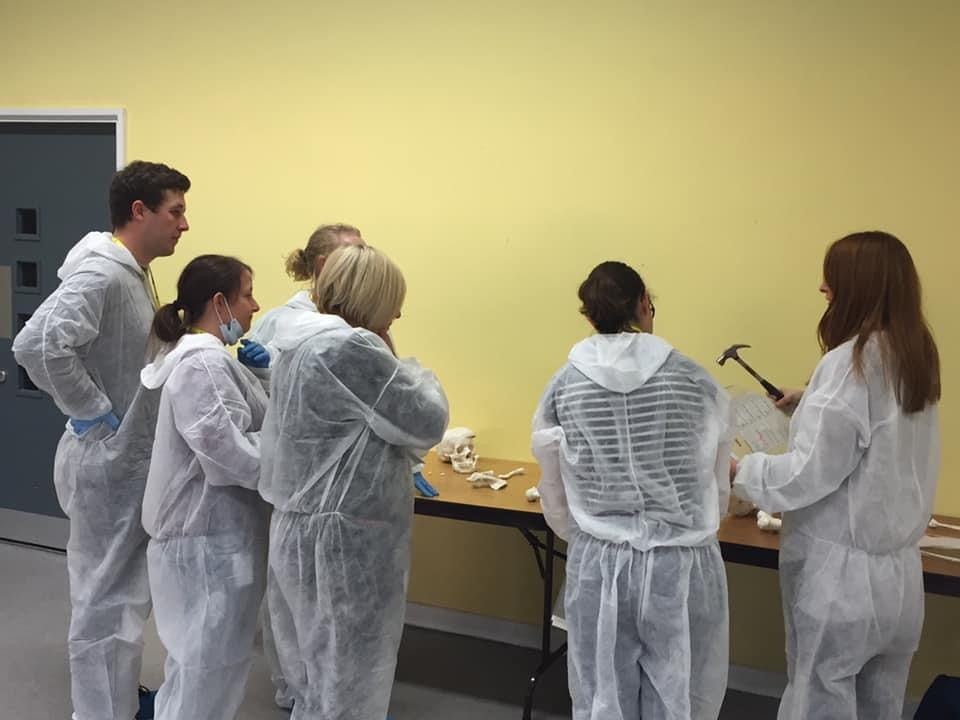 CSI Training and Events - Delegates examining a skeleton at a CSI team building event