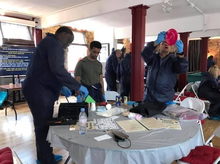 CSI Training and Events - Delegates examining items at a CSI team building event