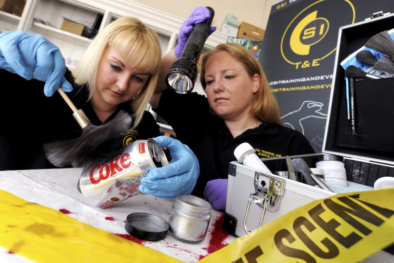 CSI Training and Events - Directors Angela and Dionne fingerprinting for a press photograph