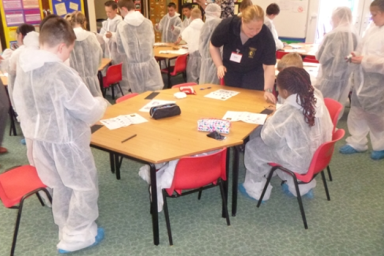 CSI Training and Events - CSI Educational Workshops - Angela helping children at a School Event