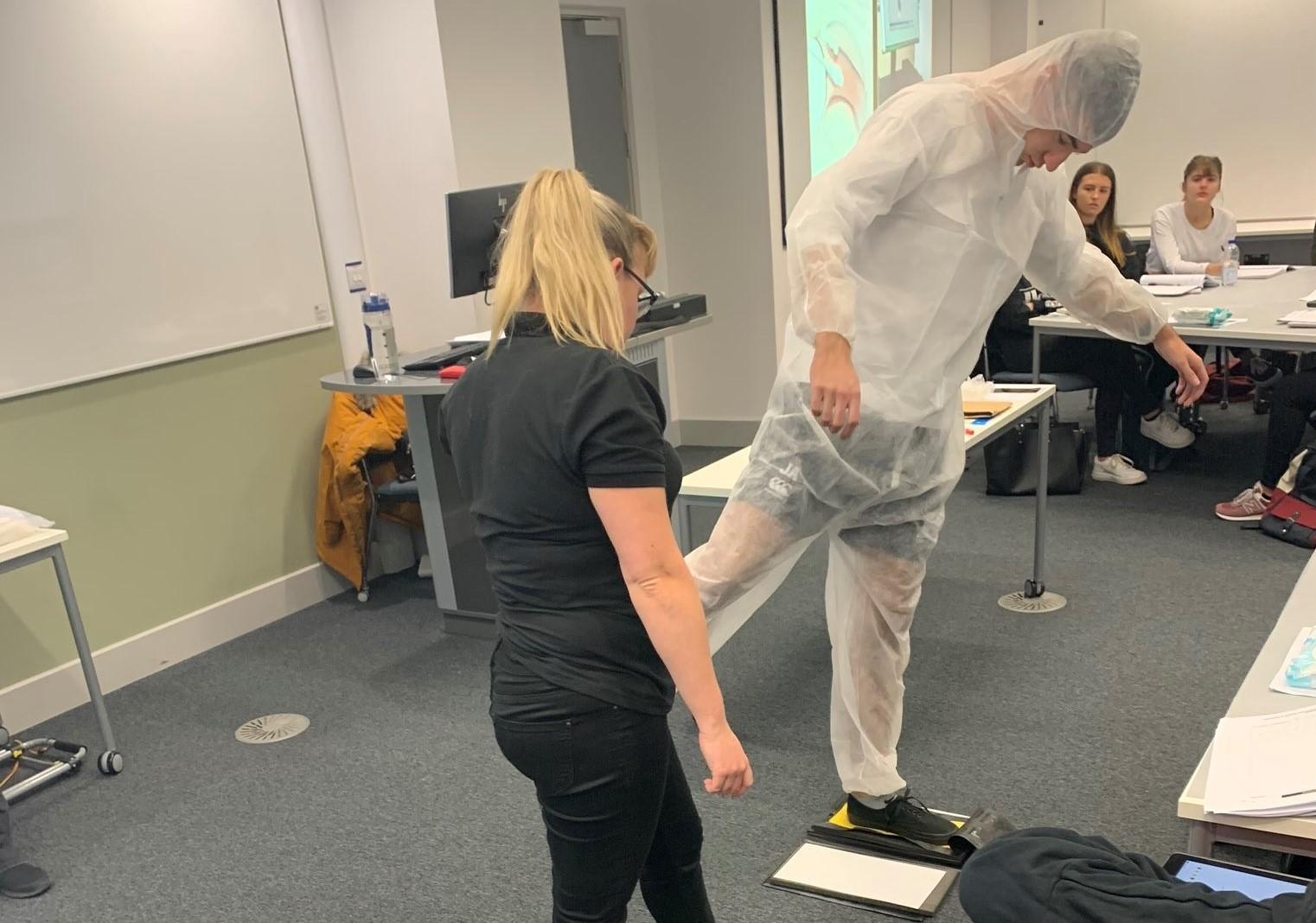 CSI Training and Events - CSI Educational Workshops - student taking part in a custody process procedure at Sheffield Hallam University